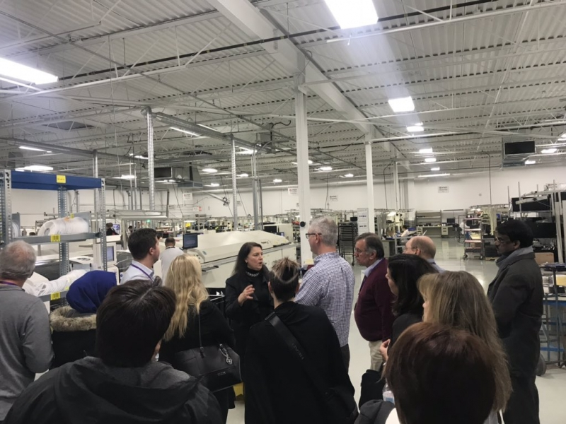 Attendees touring Urtech Manufacturing with Karen Bozynski, Director of Business Development.
