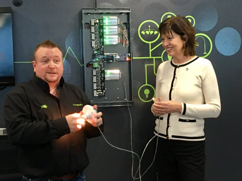 Derek Hopkins, Founder/President and CEO at iLLUMA-Drive and Pam Damoff, Member of Parliament Oakville North-Burlington demoing a CENSE green DC energy management system.