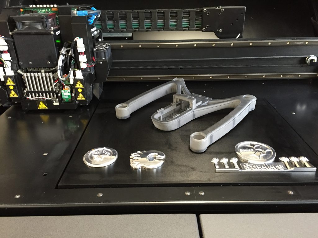 AIM 3D Printed Parts in Rigid Opaque and Transparent Material