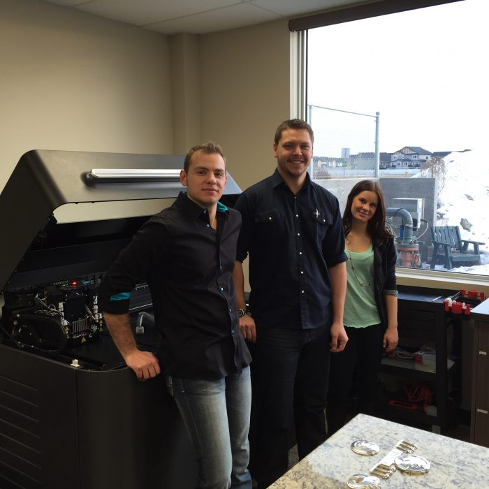 Alta Injection Molding 3D Printing Team with their Stratasys 3D Printer