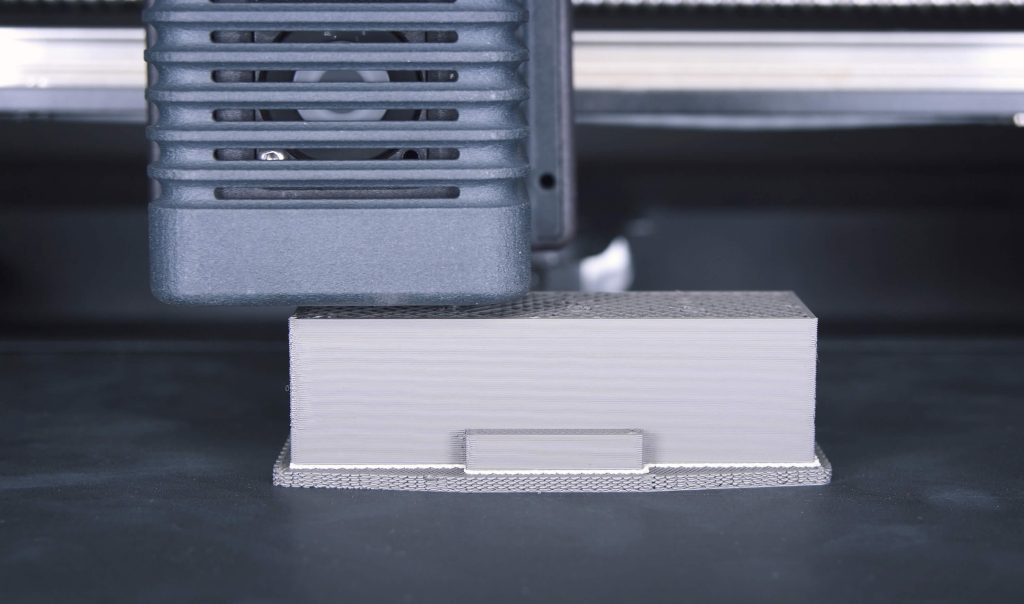 Studio System™ printing the insert layerby- layer in a process called Bound Metal Deposition™
