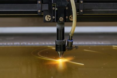 Laser system cutting plastic