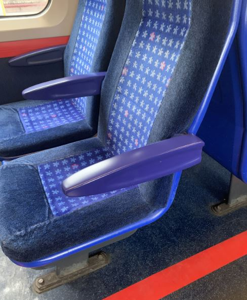 3D printed replacement part armrest on passenger train in the UK