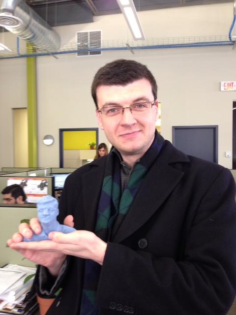 Jim Peltier holding his own statue