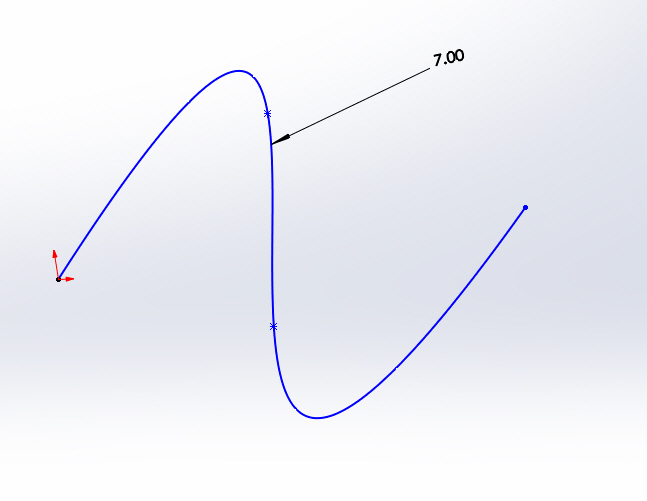 Just drop a Smart Dimension on the spline and set the length