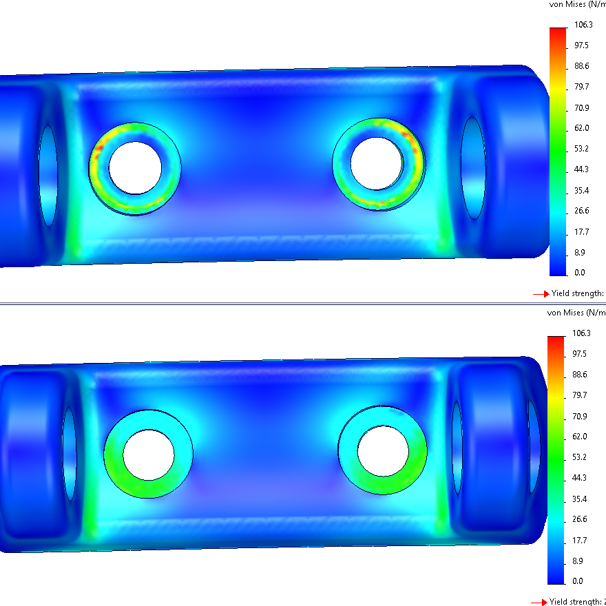 The rigid connection type (top) produces artificial stress concentrations in the bolt head region. The distributed option (bottom) produces a more realistic stress field.